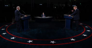 U.S. President Donald Trump (R) and former Vice President Democratic presidential nominee Joe Biden participate in the first presidential debate at the Health Education Campus of Case Western Reserve University on September 29, 2020 in Cleveland, Ohio