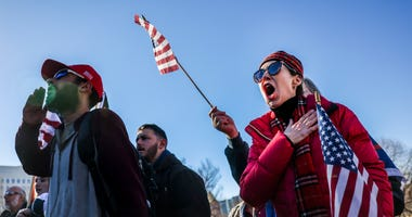 Donald Trump supporters recite the Pledge of Allegiance as they protest the election outside the Colorado State Capitol on January 6, 2021 in Denver, Colorado.