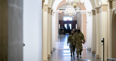 Members of the National Guard walk through the U.S. Capitol on January 11, 2021 in Washington, DC.