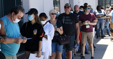 eople who are registering to vote or who need a ballot wait in line outside the Clark County Election Department, which is serving as both a primary election ballot drop-off point and an in-person voting center amid the coronavirus pandemic on June 9, 202
