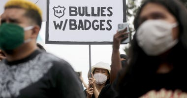 Black Lives Matter-Los Angeles supporters protest outside the Unified School District headquarters calling on the board of education to defund school police on June 23, 2020