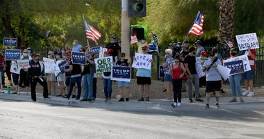 People protest against the passage of a mail-in voting bill during a Nevada Republican party demonstration at the Grant Sawyer State Office Building on August 4, 2020 in Las Vegas, Nevada