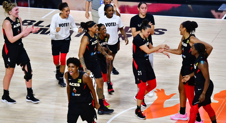 The Las Vegas Aces celebrate their series victory on=ver the Connecticut Sun on 9-29-20