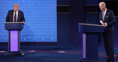 U.S. President Donald Trump and Democratic presidential nominee Joe Biden look out to the audience at end of the first presidential debate at the Health Education Campus of Case Western Reserve University on September 29, 2020 in Cleveland, Ohio.