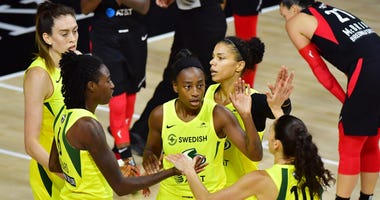 Breanna Stewart #30, Natasha Howard #6, Jewell Loyd #24, Alysha Clark #32, and Sue Bird #10 of the Seattle Storm meet after a foul during the first half of Game Two of the WNBA Finals against the Las Vegas Aces