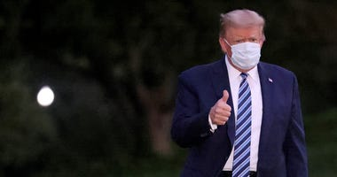 U.S. President Donald Trump gestures upon return to the White House from Walter Reed National Military Medical Center on October 05, 2020 in Washington, DC. Trump spent three days hospitalized for coronavirus
