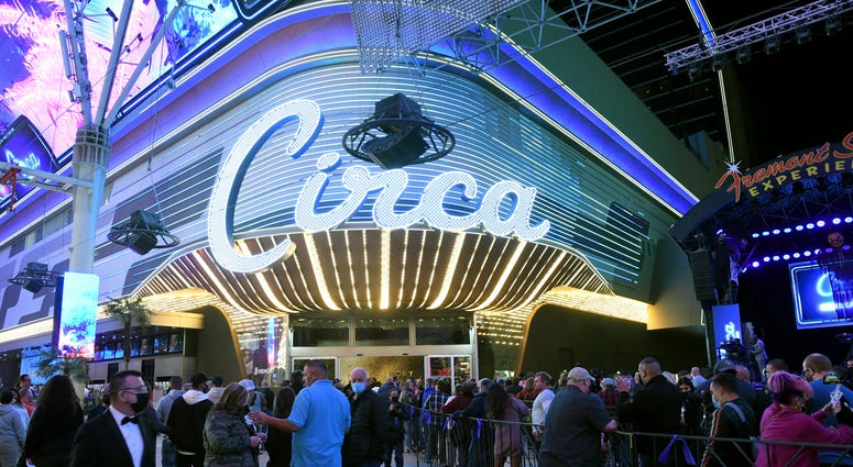 Guests stand in line at the Fremont Street Experience as they wait to enter Circa Resort & Casino during the property's grand opening on October 27, 2020 in Las Vegas, Nevada.