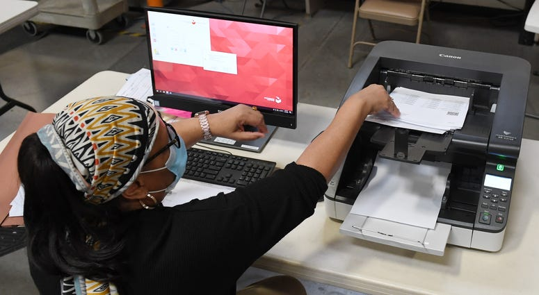 A Clark County election worker scans mail-in ballots at the Clark County Election Department on November 4, 2020 in North Las Vegas, Nevada