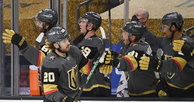 Chandler Stephenson #20 of the Vegas Golden Knights celebrates with teammates on the bench after scoring a third-period goal against the Arizona Coyotes during their game at T-Mobile Arena on January 18, 2021 in Las Vegas, Nevada. The Golden Knights defe