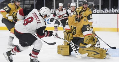 Marc-Andre Fleury #29 of the Vegas Golden Knights makes a save against Nick Schmaltz #8 of the Arizona Coyotes in the third period of their game at T-Mobile Arena on January 20, 2021 in Las Vegas, Nevada.