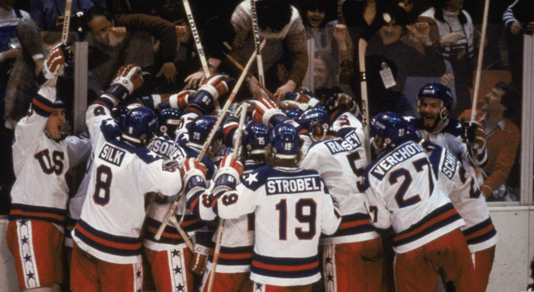 Team USA celebrates their 4-3 victory over the Soviet Union in the semi-final Men's Ice Hockey event at the Winter Olympic Games in Lake Placid, New York on February 22, 1980.