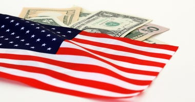 The US flag on dollar bills