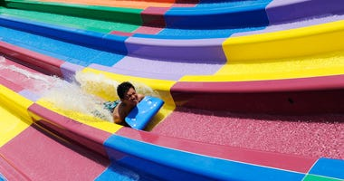 A boy enjoys a waterslide at the opening of Sydney theme park, Wet'n'Wild on December 12, 2013 in Sydney, Australia.