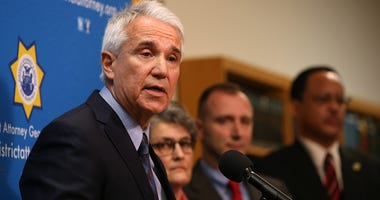 San Francisco district attorney George Gascon speaks during a new conference to announce a civil consumer protection action against rideshare company Uber on December 9, 2014 in San Francisco, California.