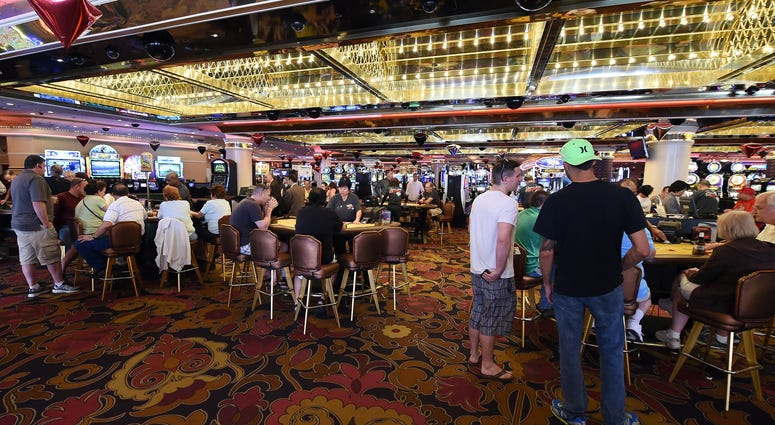 Guests gamble on the casino floor at the Riviera Hotel & Casino on April 30, 2015 in Las Vegas, Nevada.