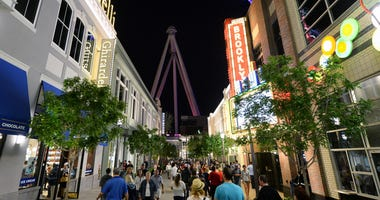A general view of people at The LINQ with the Las Vegas High Roller in the background on March 30, 2014 in Las Vegas, Nevada
