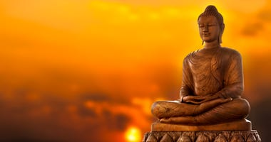 Buddha Statue and sunset background