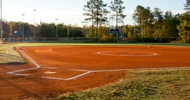Picture of a softball field at dawn