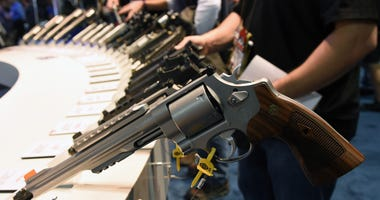 Handguns, including the model 629 .44 Magnum S&W Special (front) are displayed at the Smith & Wesson booth at the 2016 National Shooting Sports Foundation's Shooting, Hunting, Outdoor Trade (SHOT) Show at the Sands Expo and Convention Center on January 19