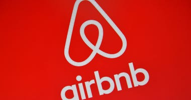 The Airbnb logo is displayed on a computer screen on August 3, 2016 in London, England.
