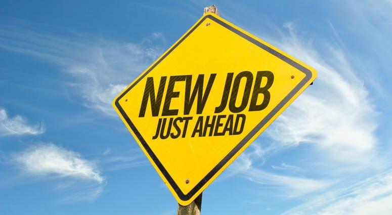 Sign advertising a job fair ahead