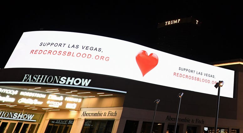 Electronic signs outside the Fashion Show mall on the Las Vegas Strip direct people to support Las Vegas by giving blood to the Red Cross in response to Sunday night's mass shooting at a music festival on October 3, 2017