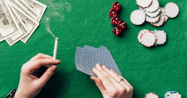 Woman smoking at a poker table