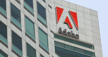 The Adobe logo is displayed on the side of the Adobe Systems headquarters January 15, 2010 in San Jose, California.