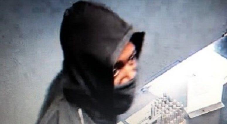 Surveillance snapshot of gun store robbery suspect