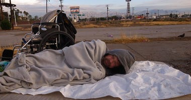 Homeless man sleeping on Las Vegas Boulevard North