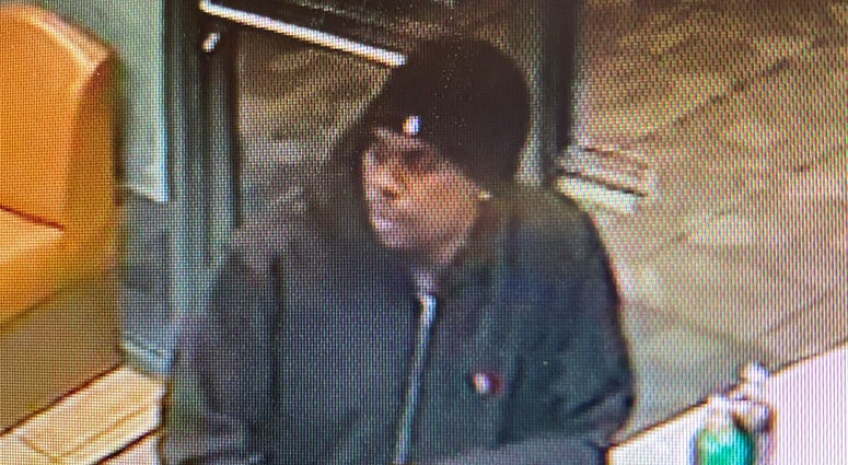 Surveillance snapshot of robbery suspect from 2-26-20