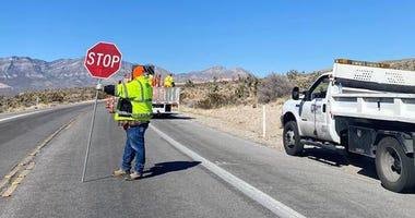 N-Dot Shot of road crew working along SR 159