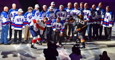 "Mike Eruzione participates in a ceremonial puck drop before the start of a game between the Vegas Golden Knights and the Florida Panthers at T-Mobile Arena in commemoration of the 40th anniversary of the ""Miracle on Ice."""