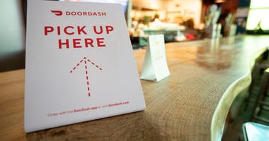 A Door Dash sign sits on the counter Monday, March 16, 2020,