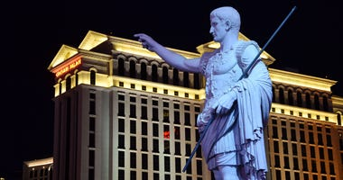 General view of Caesars Palace entrance of statue and hotel tower.