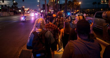 Las Vegas residents take to the streets to march in solidarity with Black Lives Matter Tuesday, June 2, 2020.