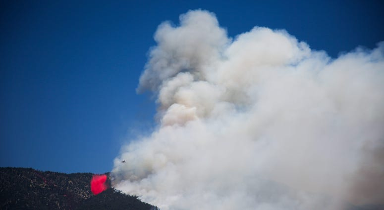 An air tanker drops retardant in Banning, Calif. as the Apple Fire burns on Sunday, August 2, 2020.