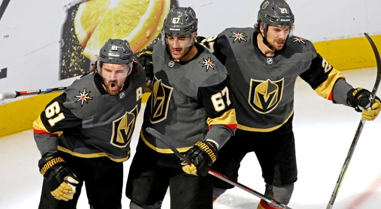 Vegas Golden Knights right wing Mark Stone (61) celebrates scoring a goal with Vegas Golden Knights left wing Max Pacioretty (67) and defenseman Shea Theodore (27) during the second period against the Chicago Blackhawks