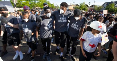 Giannis Antetokounmpo and Bucks teammates march at a protest Saturday in Milwaukee.