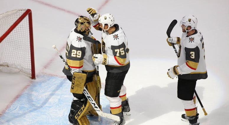 Vegas Golden Knights goaltender Marc-Andre Fleury (29) right wing Ryan Reaves (75) and defenseman Brayden McNabb (3) celebrate the 5-3 victory against the Vancouver Canucks