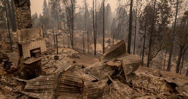 Remnants of homes, cars, bicycles and street signs litter the path left by the Creek Fire in Big Creek, Calif., on Tuesday, Sep. 8, 2020.