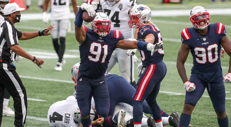 New England Patriots defensive end Deatrich Wise (91) recovers a fumble for a touchdown during the second half against the Las Vegas Raiders at Gillette Stadium