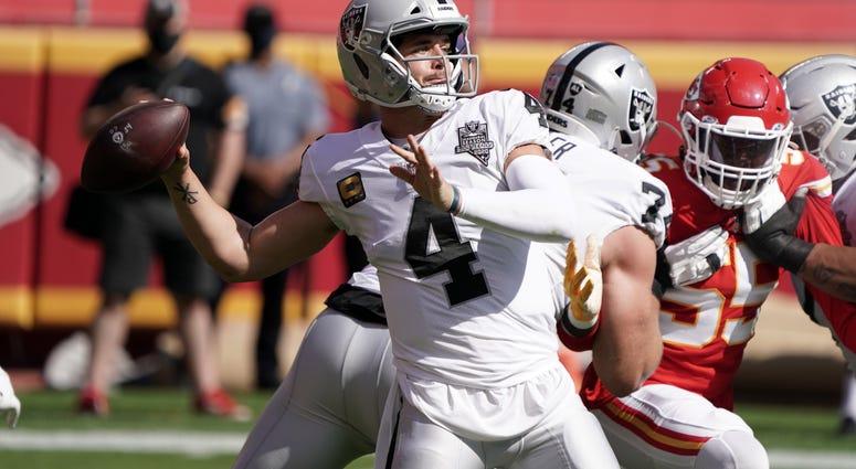 Las Vegas Raiders quarterback Derek Carr (4) throws the ball in the first quarter against the Kansas City Chiefs at Arrowhead Stadium.