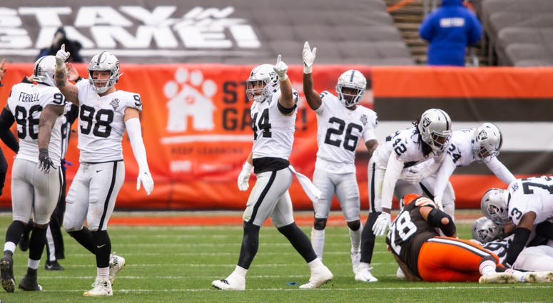 The Las Vegas Raiders signal for possession following a fumble recovery against the Cleveland Browns during the first quarter at FirstEnergy Stadium.