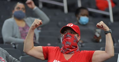 A UNLV Rebels fan flexes for the camera during a time out between the UNLV Rebels and the Fresno Bulldogs at Allegiant Stadium.