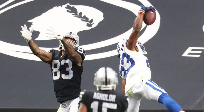 Indianapolis Colts cornerback Kenny Moore II (23) makes a one handed interception catch against Las Vegas Raiders tight end Darren Waller (83) at Allegiant Stadium.