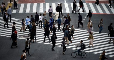 The Latest: Japan Set To End Tokyo's State Of Emergency