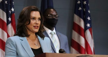 The Latest: Michigan Gov. Whitmer Toughens Mask Requirement