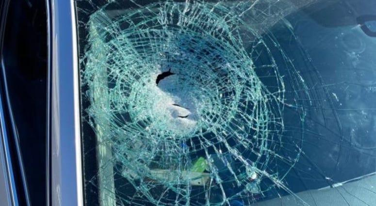 Broken windshield from rock throwing incident