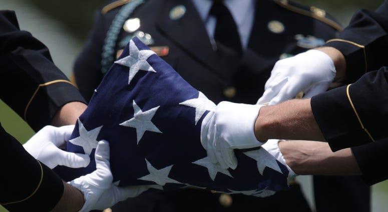 folded flag at veterans day ceremony